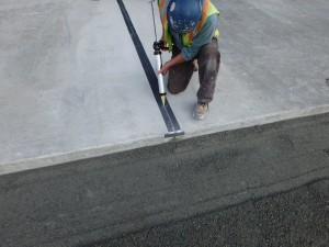 photo-2-installing-sealant-in-apron-slab-joints