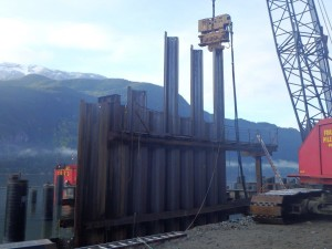 Photo 2 - Installing bulkhead wall sheet piles with vibratory hammer